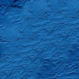 Rough dark blue plaster applied to the wall surface royalty free stock photo