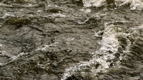 Rough dark choppy water moving stock footage