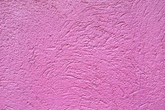 Rough deep pink wall background.  royalty free stock images