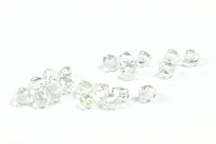 Rough diamonds. On white background stock images