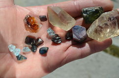 Rough gems. Outdoors in a man's hand royalty free stock photo