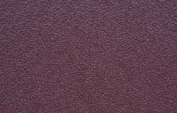 Rough grain Sand paper texture. Red Stock Image