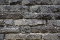 Rough granite stone wall. Rough granite stone brick wall background Stock Photo