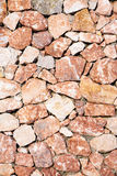 Rough granite wall. Of red Stock Images
