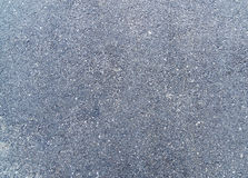 Rough granulated old asphalt texture. With spots Stock Images