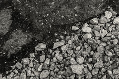 Rough gravel meets smooth Tarmac in black and white - using diagonal composit Stock Photo
