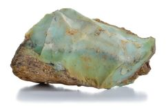 Rough green opal (chryzopal) veins mineral. Stock Photo