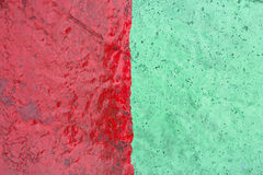 Rough green and red cement wall texture background Stock Photography