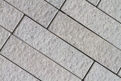 Rough grey tiles wall Stock Photo
