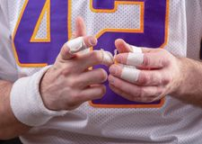 Rough Hands Of American footballer. Taped fingers Of American footballer stock photos