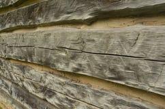 Rough hewn vintage wood detail. Detail of rough hewn wood of rustic vintage log cabin Royalty Free Stock Photos