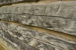 Rough hewn vintage wood detail. Detail of rough hewn wood of rustic vintage log cabin Royalty Free Stock Images