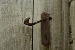 Rough hewn wood texture detail. Full frame view of rustic wood vintage log cabin door and door handle Stock Photography