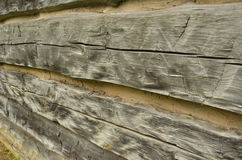 Rough hewn wood texture detail. Full frame view of rustic wood vintage log cabin wall Stock Image
