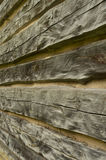 Rough hewn wood texture detail. Full frame view of rustic wood vintage log cabin wall Stock Photo