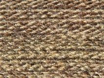 Rough knit camel wool fabric texture taken closeup. Royalty Free Stock Photos