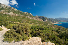 A rough landscape on Karpathos, Greece. With a nice view at the ocean Stock Photos
