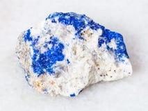 rough Lazurite (Lapis Lazuli) gemstone on white