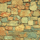 Rough mediterranean stone wall as background. Royalty Free Stock Photo