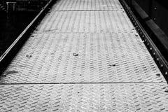 Rough metal floor. On a bridge Royalty Free Stock Image