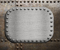 Rough metallic plate over rusty metal background Stock Images