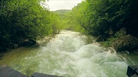 Rough Mountain River Flowing Down In Lush Green stock footage