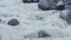 A rough mountain river among stones. Slow mo stock video