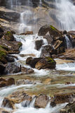 Rough mountain river with waterfall. Rough mountain river with a waterfall flowing between rocks stock image