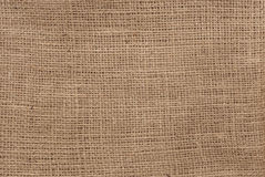 Rough natural brown burlap Stock Photos