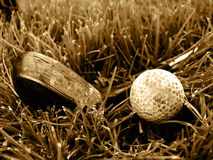 Rough old gold club and ball stock photo