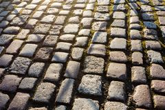 Rough old stone footpath with moss, close up image stock images