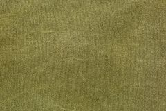 Rough olive canvas texture. Horizontal piece of rough canvas fabric, olive colored. Vintage style unevenly painted dense textile with traces of usage Stock Image