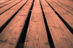 Rough orange grayish orangish wooden stage background with low d Royalty Free Stock Images