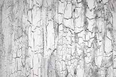 Rough painted wooden surface with cracks, neutral background Royalty Free Stock Images