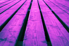 Rough pink blue purplish turquoise bluish violet wooden stage ba. Ckground with low depths of field. Fine artistic backgrounds of almost gray resulting from Stock Image