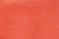 Rough pink canvas texture. Horizontal background capture of faded red canvas fabric texture. Rough dense rag of retro style textile with traces of usage Royalty Free Stock Photography