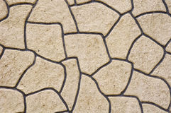 Rough plaster imitation stones on wall Royalty Free Stock Image