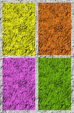 ROUGH PLASTER TEXTURES. Rough plaster based coloured texture in yellow, orange, purple and green Stock Photo
