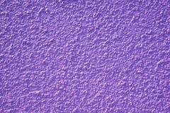 Rough purple bulge concrete wall background, texture.  royalty free stock photos
