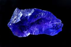 Purple Halite. Rough purple halite from Saskatchewan. focus stack for maximum depth of field; isolated on black Royalty Free Stock Images
