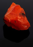 Rough red carnelian rock isolated on black Stock Image