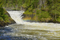 Rough river with rapids and rainbow Royalty Free Stock Image
