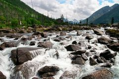 Rough river and rocks. Royalty Free Stock Images