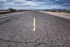 Rough Road Driving. Rough road leading into the Mojave Desert east of Barstow, California Royalty Free Stock Image