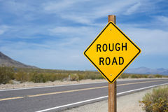 Rough Road Sign. Mojave Desert Stock Images