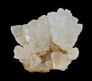 Rough rock salt crystals on the black background Royalty Free Stock Photography