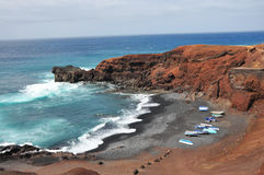 Rough and rocky coast of spanish volcanic island lanzarote Stock Images