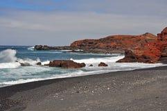 Rough and rocky coast of spanish volcanic island lanzarote Stock Image