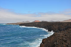 Rough and rocky coast of spanish volcanic island lanzarote Royalty Free Stock Photo