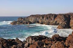 Rough and rocky coast of spanish volcanic island lanzarote Royalty Free Stock Photos